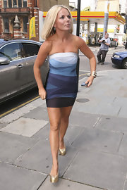 Geri Halliwell showed off her toned physic in a strapless dress, which she paired with gold platform pumps.