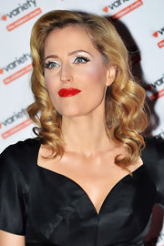 Gillian Anderson was pure pin-up girl glam with smooth, wavy locks, cat eye liner and a classic red pout at the Hidden Gems Photography Gala Auction.