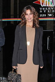 Gina Gershon looked business-like yet stylish in a black blazer layered over a nude sheath as she left the 'Wendy Williams Show.'