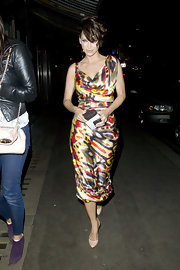 Sarah Harding paired her vibrant print dress with nude pumps with black stitching.