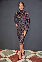 Ciara was sexy glam at the Hogan by Karl Lagerfeld in a baroque-inspired sheer dress paired with a black bodysuit and black stilettos.