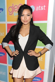 Naya Rivera styled her hair in a loose half up hairstyle with soft bangs that lay beside her face.
