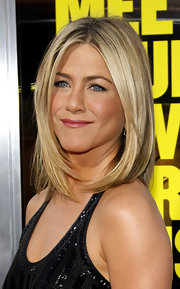 Jennifer Aniston always looks amazing on the red carpet. She kept her hair simple and sleek with a straight center part cut.