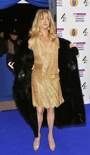 Goldie dons a sparkling gold cocktail dress at the British Comedy Awards in London.