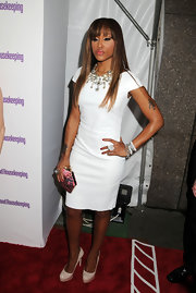 Eve was head-to-toe classic at the Shine On Awards in a white sheath dress and nude platform pumps.
