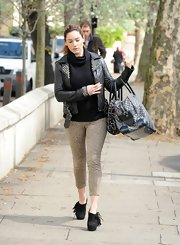 Kelly Brook stepped out in London wearing a pair of black platform booties featuring fringe.