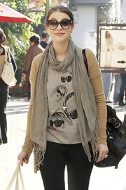 Michelle Trachtenberg didn't only wear sunglasses, she also wore a tee-shirt emblazoned with faces wearing sunglasses.