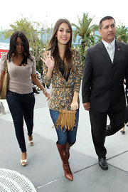Victoria Justice went for an earthy look with a tan suede tasseled shoulder bag.