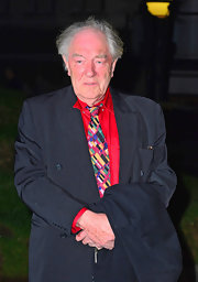 Michael Gambon added some fun to this look with a colorful tie.