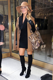 Gretchen Rossi looked dynamite in sleek black over the knee platform boots.