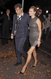 Kate Moss sparkled at the Paul McCartney wedding reception in an iridescent bronze mini dress.