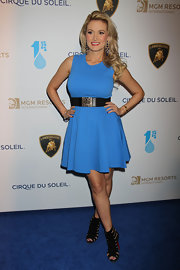 Holly Madison showed off her post-baby body with this fitted, A-line dress with a black belt as an embellishment.
