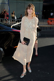 Alexa Chung hit the CFDA Awards in  nude long-sleeve dress which she finished off with a black leather clutch.