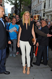 Gwyneth looked totally chic and sophisticated in a structured black blouse and white pants.