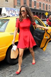 Pippa Middleton was a doll in this sweet silk fit-and-flare dress. She looks great in red, doesn't she?