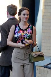 While filming 'Gossip Girl,' Leighton Meester gave her wide-legged pants and floral top a feminine finish with a two-tone leather Aphrodite shopper.