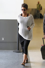Halle Berry's loose-fitting white maternity top gave the expecting mom a casual look while out at LAX.