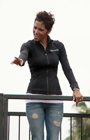 Halle repped Revlon in her logo zip-up jacket for their walk/run benefit.