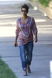 Halle Berry stepped out sporting a boho-inspired look with this printed tunic blouse and cuffed jeans.
