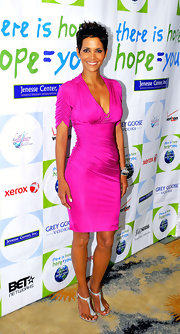 Halle was simply glowing at the Silver Rose Gala in a magenta cocktail dress.