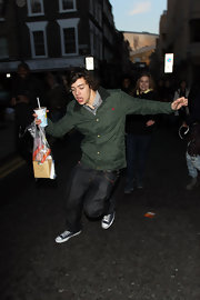 Harry Styles goofs around in a pair of blue denim jeans.