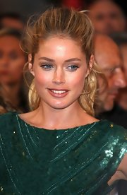 Doutzen Kroes kept her makeup minimal and swept on a just a touch of tinted lipgloss.