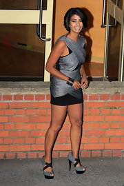 Konnie made a killer match to her bandage dress with killer silver and black platform sandals.