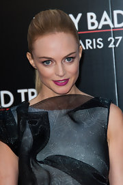 A sleek and straight ponytail topped off Heather Graham's look at the Paris premiere of 'The Hangover Part III.'