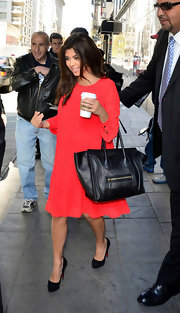 Kourtney Kardashian arrived in NYC to promote the Nokia Lumia 900 while wearing a pair of ultra-high black platform pumps.