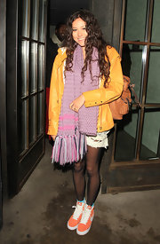 Eliza wears a purple knit scarf with long fringe for this eclectic outfit in London.