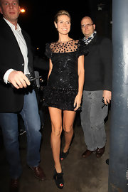 Heidi Klum sizzled in black suede Jem Velours peep toe booties with gold rivets and buckles.