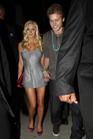 """Heidi wore a hot pink pair of satin """"Feticha"""" pumps with a matching clutch and silver mini dress."""