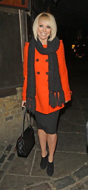Liz Mcclarnon brightened up her evening look with a bright orange pea coat.
