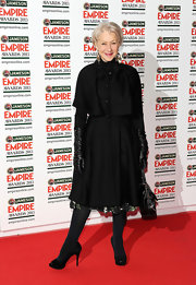 Helen Mirren chose this classic evening coat to pair over her cocktail dress while out at the Empire Film Awards.