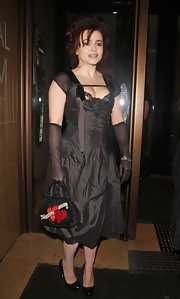 Helena Bonham Carter carried a black satin evening bag with tattoo-inspired embellishments.