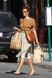 Helena Christensen paired her casual look with an earthy stitched cognac leather shoulder bag.