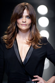 Helena Christensen strutted down the runway with long straight locks and face framing bangs.