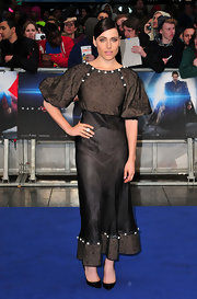 Antje Traue's black and gray puffed-sleeve dress looked cool on the model at the 'Man of Steel' premiere in London.