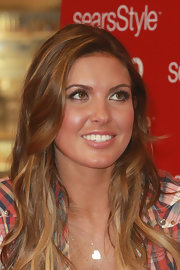 Audrina Partridge accented her eyes with neutral shadow while greeting her fans at Sears. To get her look, try a rich brown eye pencil for lining upper and lower lash lines and sweep a taupe shadow along  top lids and blend into creases. A light pink or gold shadow can be used to highlight the inner corners of eyes and under the brow bones.