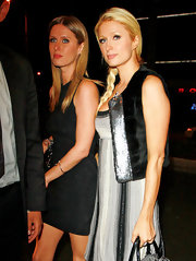 Paris donned a sequined furry vest for her outing with her sis in Hollywood.