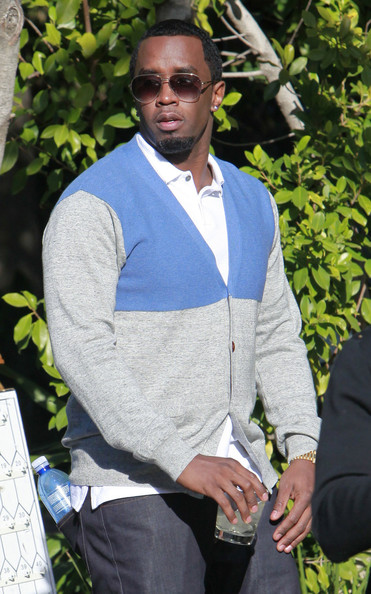 Sean Combs went for a preppy look with this blue and gray cardigan layered over a polo shirt during a party in Beverly Hills.
