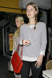 Nicky Hilton looked ready for spring while grabbing a bite with her sister Paris. She polished her tips with pastel blue polish.