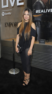 Zara bared some shoulder at the Emporio Armani Summer Garden Party when she sported this cold-shoulder black top.