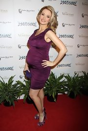 Holly Madison showed off her growing figure in this ruched plum cocktail dress at the 'Rock of Ages' show.