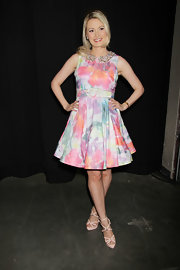 A pastel, watercolor dress with an embellished collar looked fun and flirty on Holly Madison.