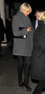 Cameron Diaz continued to show off her fab outerwear collection in a modern charcoal coat with an oversize collar.