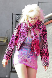 Angelyne pulled off a print-on-print look with a pink leopard cropped jacket over a floral mini dress.