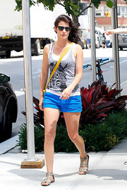 Cobie stuck to electric blue short shorts for her casual look.