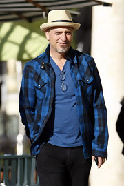 Howie Mandel exuded a grunge vibe with his unbuttoned flannel shirt.