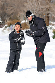 Oscar Jackman wore a puffa parka to keep warm and toasty as he geared up for a snowball fight.